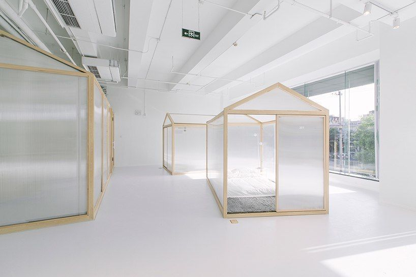 cao pu pitches tent structures inside together hostel in beijing
