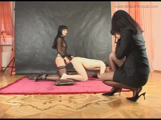 02 - two ladies in sheer black nylon take turns straponing a male ass and taking pictures of it