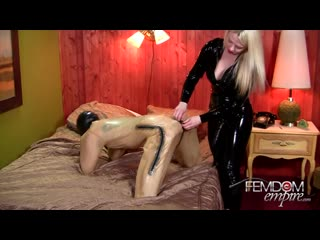 Latex mistress with strapon used on guy in latex a bondage dog suit