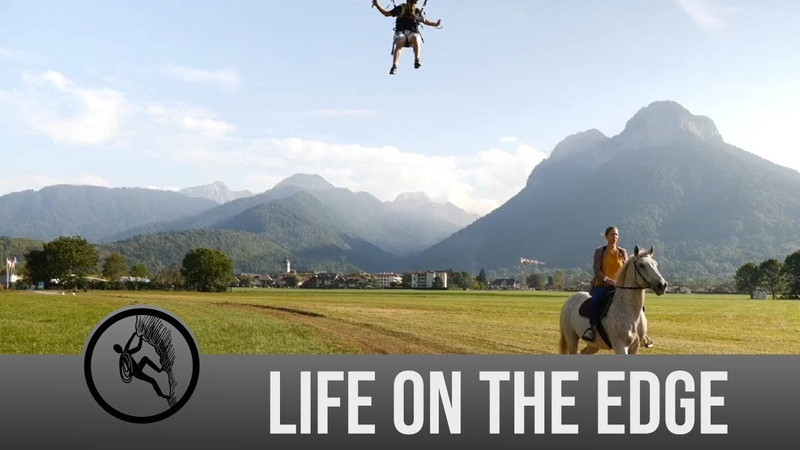 Daredevil paraglides onto the back of a moving horse