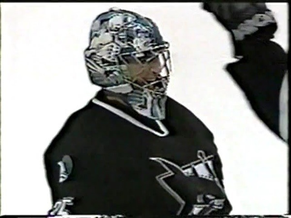 Goalie Evgeni Nabokov San Jose Sharks scores a goal against Canucks 2002